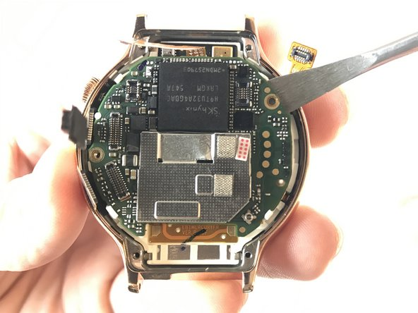 Use the Metal Spudger to lift the mother board from the watch.