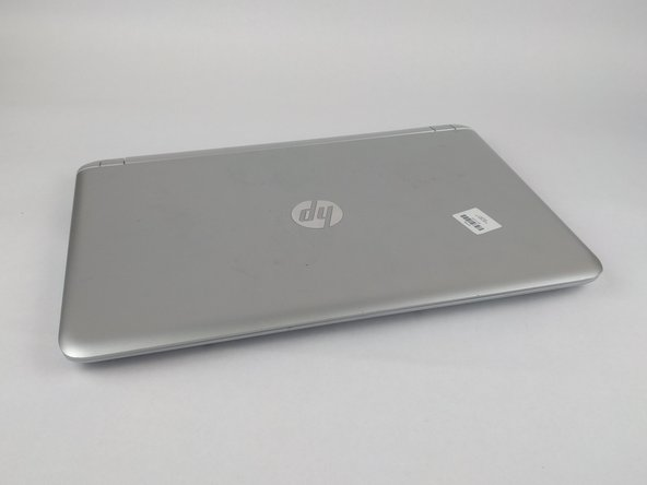 Flip the laptop on its back side, having the battery facing toward you.
