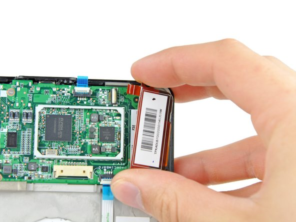 Gently remove the touchscreen controller by lifting it up and to the right.