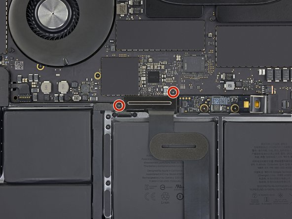 Use a T3 Torx driver to remove the two 1.9 mm screws securing the cover bracket for the keyboard and trackpad cable connectors.