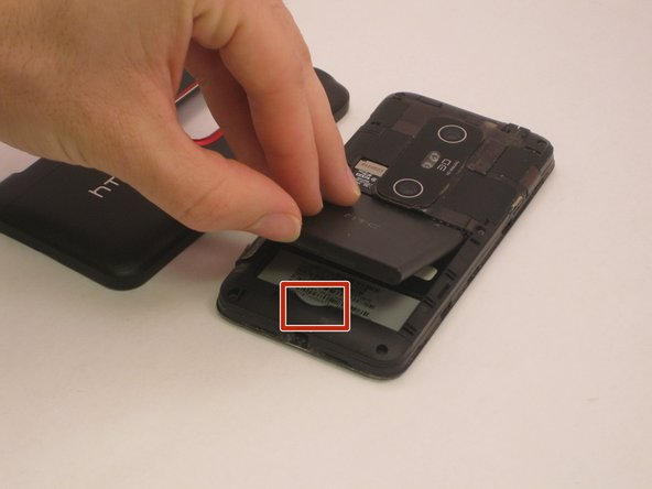 Remove the battery with your hands, lifting at the marked area.