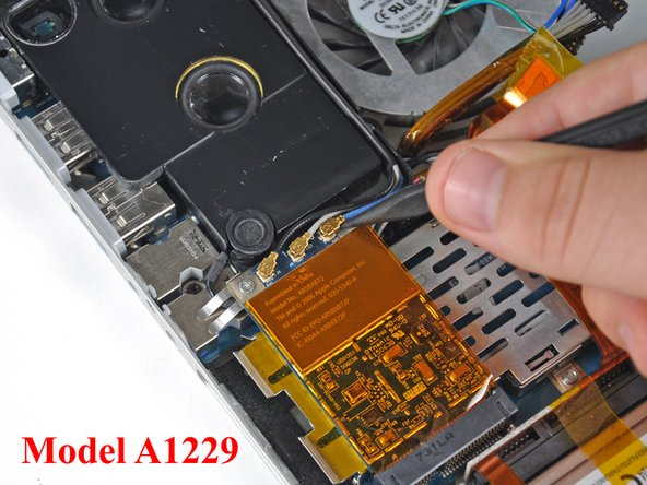 "Image 2/3: If you have a MacBook Pro 17"" Model A1229, there are three antenna cables attached to the AirPort Extreme card instead of two."