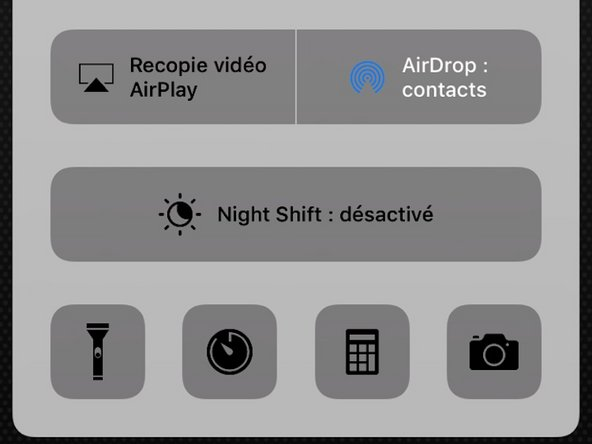 Show up the Control Center by sliding your finger from the down side of the screen to the middle of it.