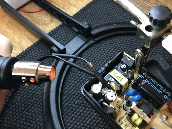 Place the heat shrink shield over the soldering and apply heat to seal