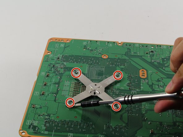 Flip the motherboard over to the back and find the metal x-shaped bracket.