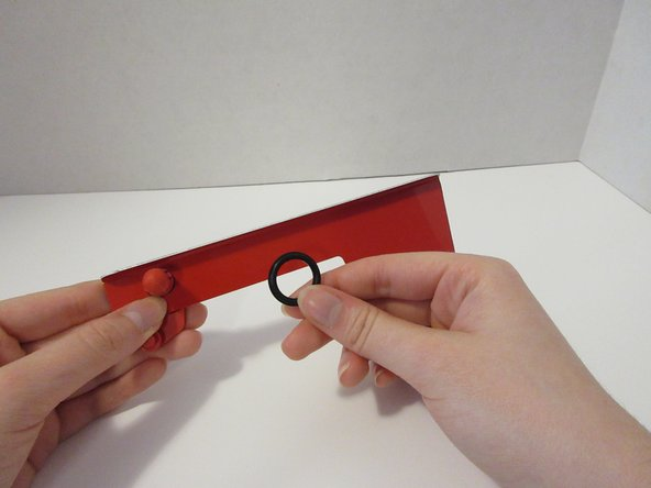 Place the rubber o-ring  onto the bracket.