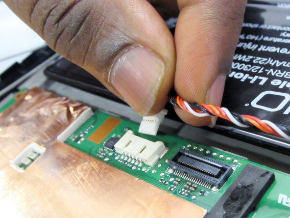 Remove the connector at the top of motherboard by pulling the connector away from the motherboard with fingers or tweezers.
