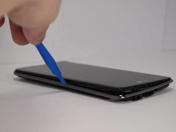 The frame is held to the rest of the phone with plastic tabs. Release each tab one at a time around the phone for easiest removal.