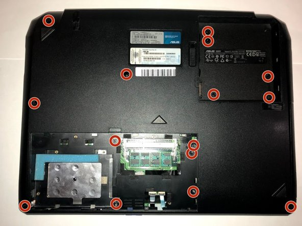 Remove the fifteen 4.2 mm screws on the bottom of the laptop with a Phillips #0 screwdriver, under the battery, and beneath the back panel that secure the keyboard to the laptop.