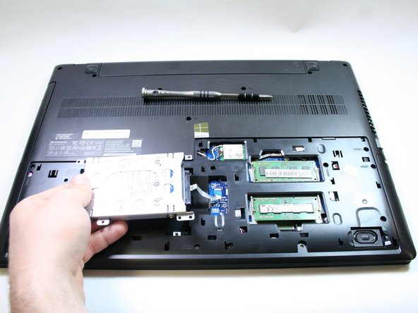 Gently pick up the hard drive without pulling it completely out.