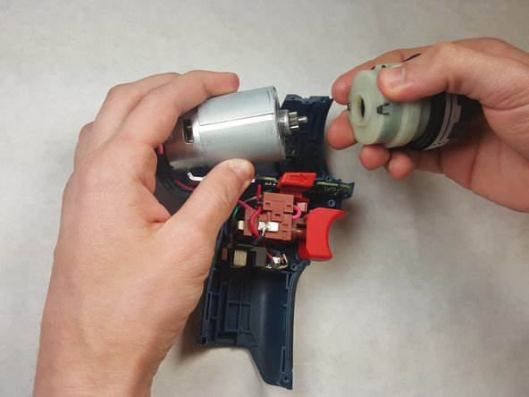 Image 2/2: Carefully remove the gearbox from the motor assembly.
