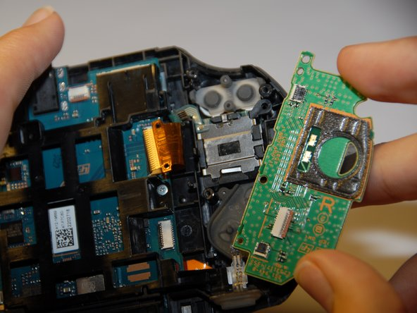 Once the green casing has been removed you are now be able to see the button pads that need to be removed.
