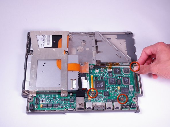 Remove the three cylindrical silver spacers placed on top of the motherboard.