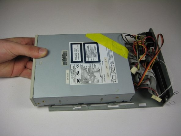 Slide the internal drive component away from the back of the device.