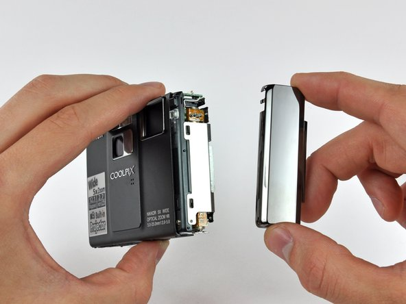 Image 3/3: Interestingly, the controls along the top of the camera are attached to a board below the top cover. The top cover just houses the button covers.
