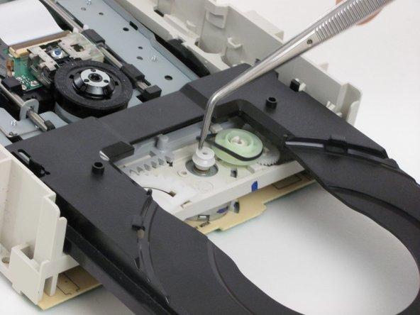 Remove the old belt using tweezers.