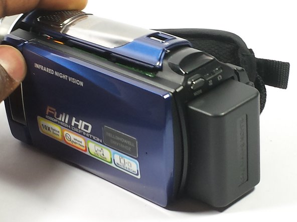 The battery is located on the back of the camera.