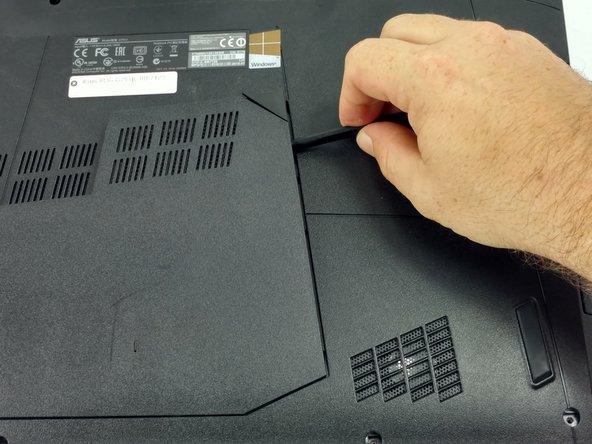 Using the nylon spudger, remove the back center panel.