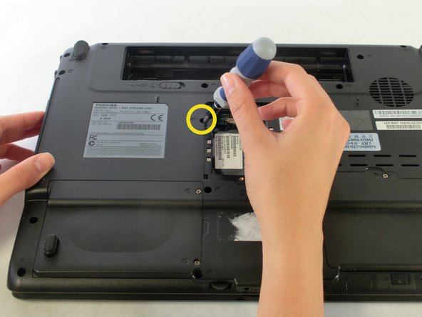 Use a PH0 screwdriver to remove the screw holding the optical drive in place.