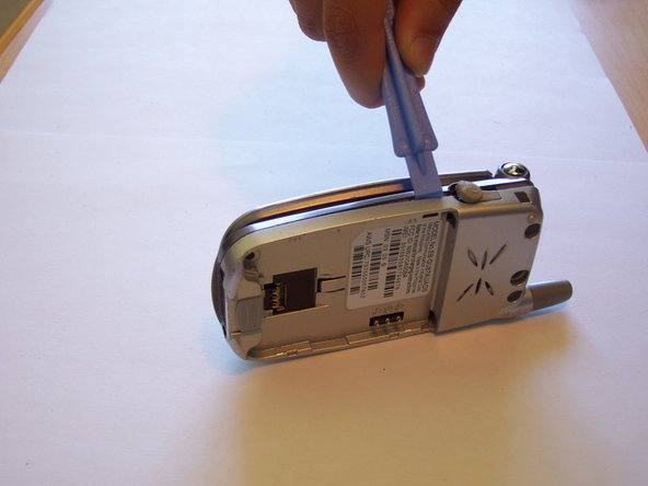 Use a plastic opening tool to separate the front and back casing.
