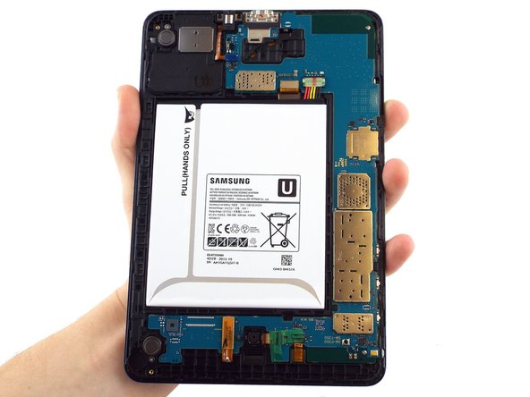 The second picture shows the internal portion of the device once the back cover is removed.