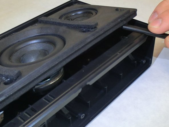 Continue to the next step before attempting to lift the speaker assembly from the rest of the speaker entirely to avoid damaging internal wires.