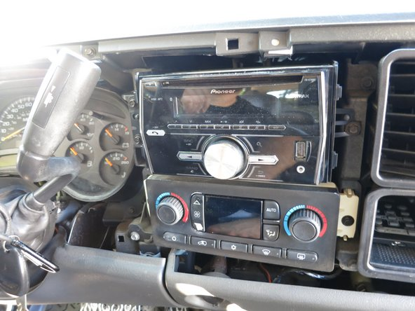 To do this, pull out on both the left and right sides to release the head unit from its clips.