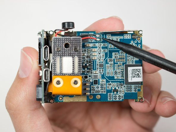 Locate the solder points connected to the red and black wire on the back of the motherboard.
