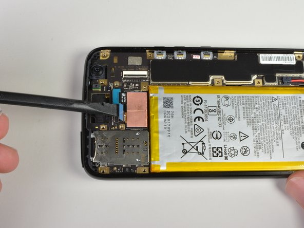 Use flat edge of the spudger to pry up the two blue connectors near the top of the device.