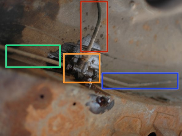 Find the brake line distributor at the rear of the car where the two hard lines split off to each wheel. It is just up behind the driver's side axle.