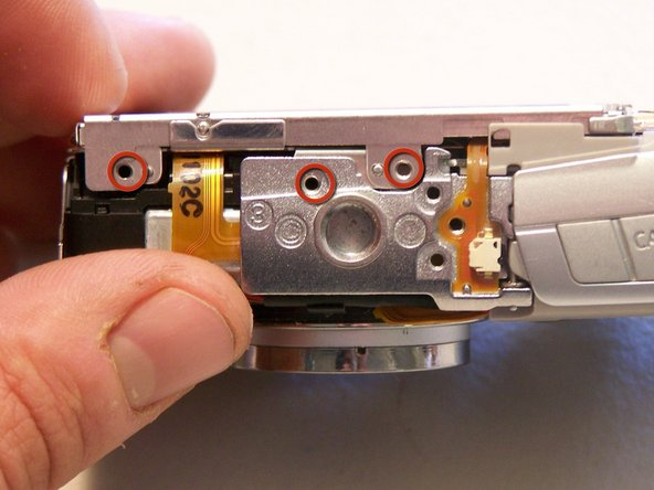 Remove the three screws attached to the bottom of the LCD brackets