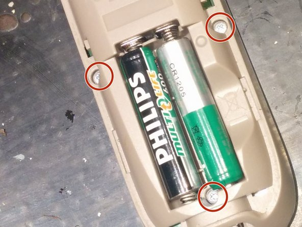 Remove the batteries and the 3 screws