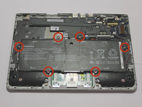 Remove six 3.5 mm screws holding the battery using a Phillips #00 screwdriver.