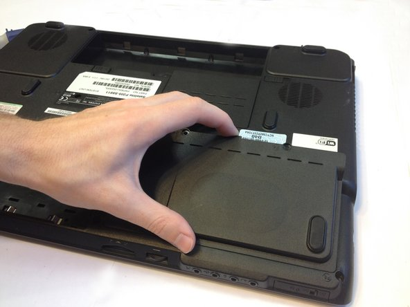 Also remove the two 4mm Phillips #1 screws holding in the bottom right cover on the bottom of the laptop.