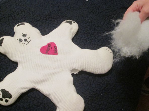 Use Polyester Fiberfill stuffing to fill the stuffed bear via rip. Add more stuffing for a firmer toy.