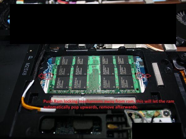 Look for the ram module bay. It will be found on the lower half of the notebook in the middle.