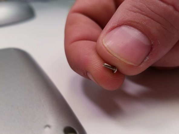 Remove the six 5mm Phillips #00  screws from the back of device.