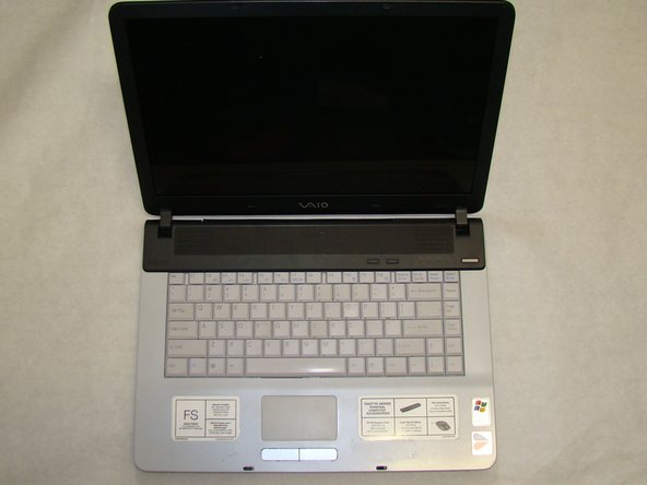 After the screws are removed, flip the laptop over so the keyboard is facing up and move the screen to its upright position.