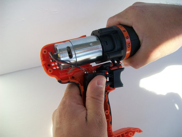 Gently remove the top part (motor and chuck) from the rest of the drill.
