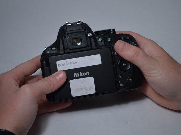 Image 2/3: Remove the 12-mm screw.