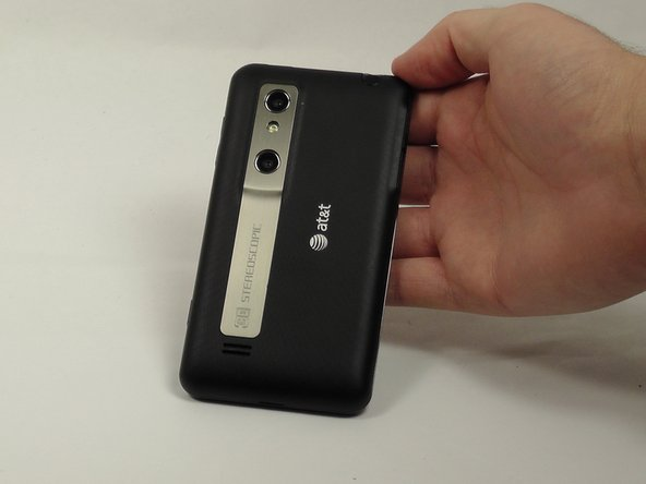 Remove the back cover of the phone using your fingernail or a plastic opening tool.