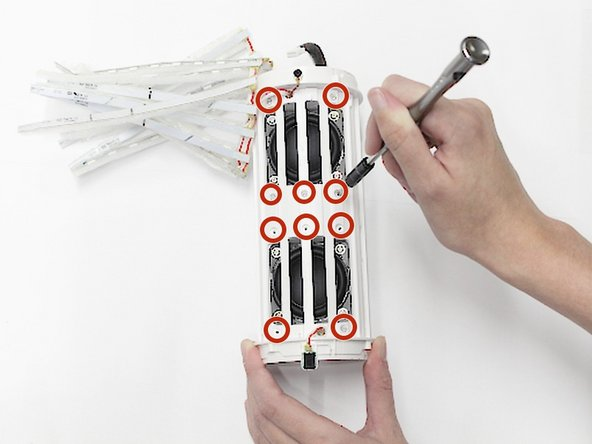 Use the Phillips #1 screwdriver to remove the ten 9.5mm screws that hold the cage in place.