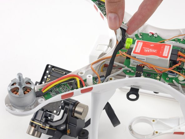 Pull the gimbal wire through the case bottom shell and plug in the connector to the G8 plug on the mainboard.