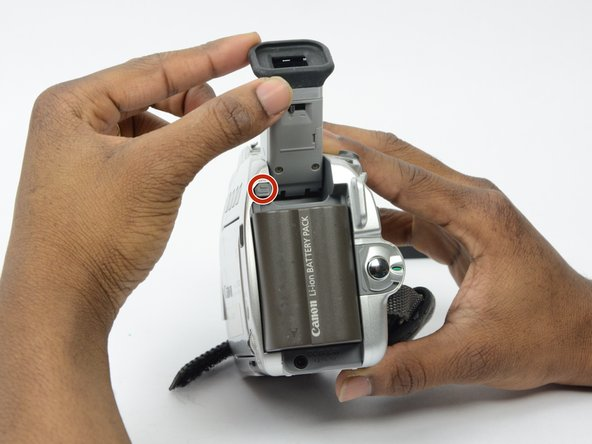 Raise the eyepiece to allow easier access to battery pack.