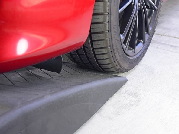 Make sure each ramp is centered in the path of the tire so that once the vehicle moves forward, both wheels will stay completely supported by the ramps.