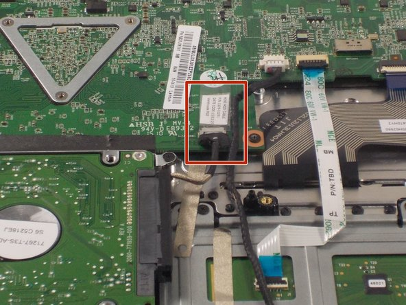 Follow the wire out from the right side of the hard drive to locate where the hard drive connects to the motherboard.