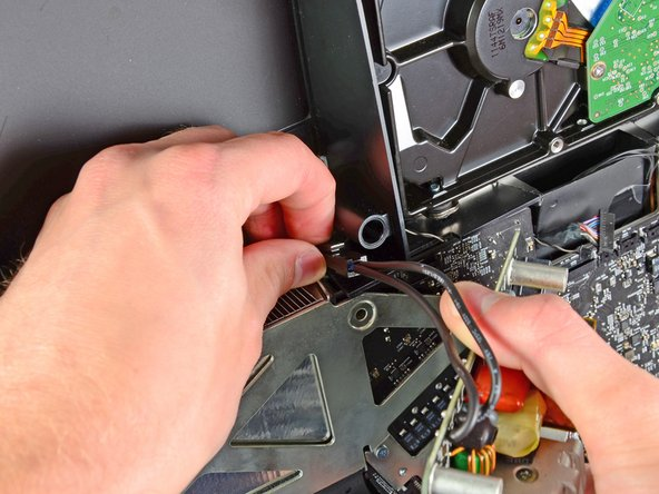 Image 1/1: Remove the power supply from the outer case.