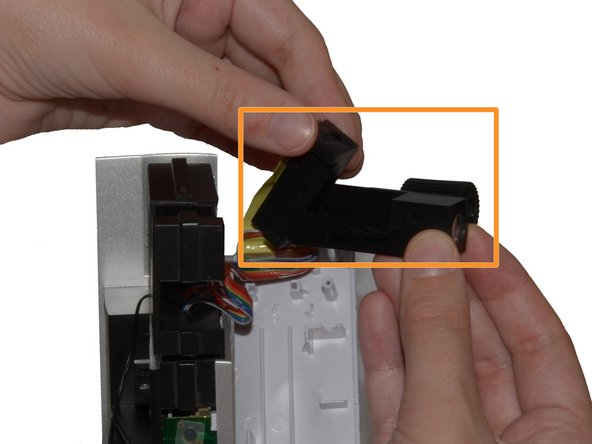 Hold the Component in one hand and lift the Projection Beam up and away from the Focus Knob.