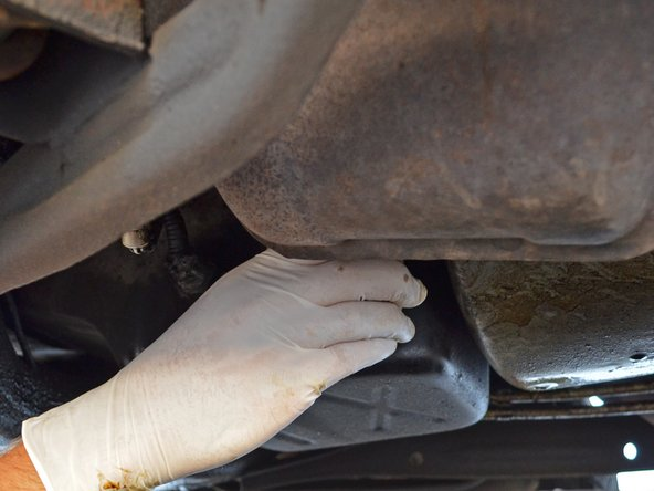 Loosen the oil filter by turning it counter-clockwise with your hand or an oil filter wrench.