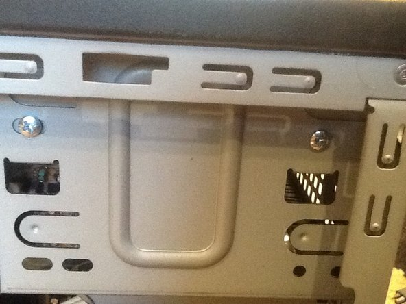 Now remove the 2 screws from the DVD player. Disconnect the cables and remove it.